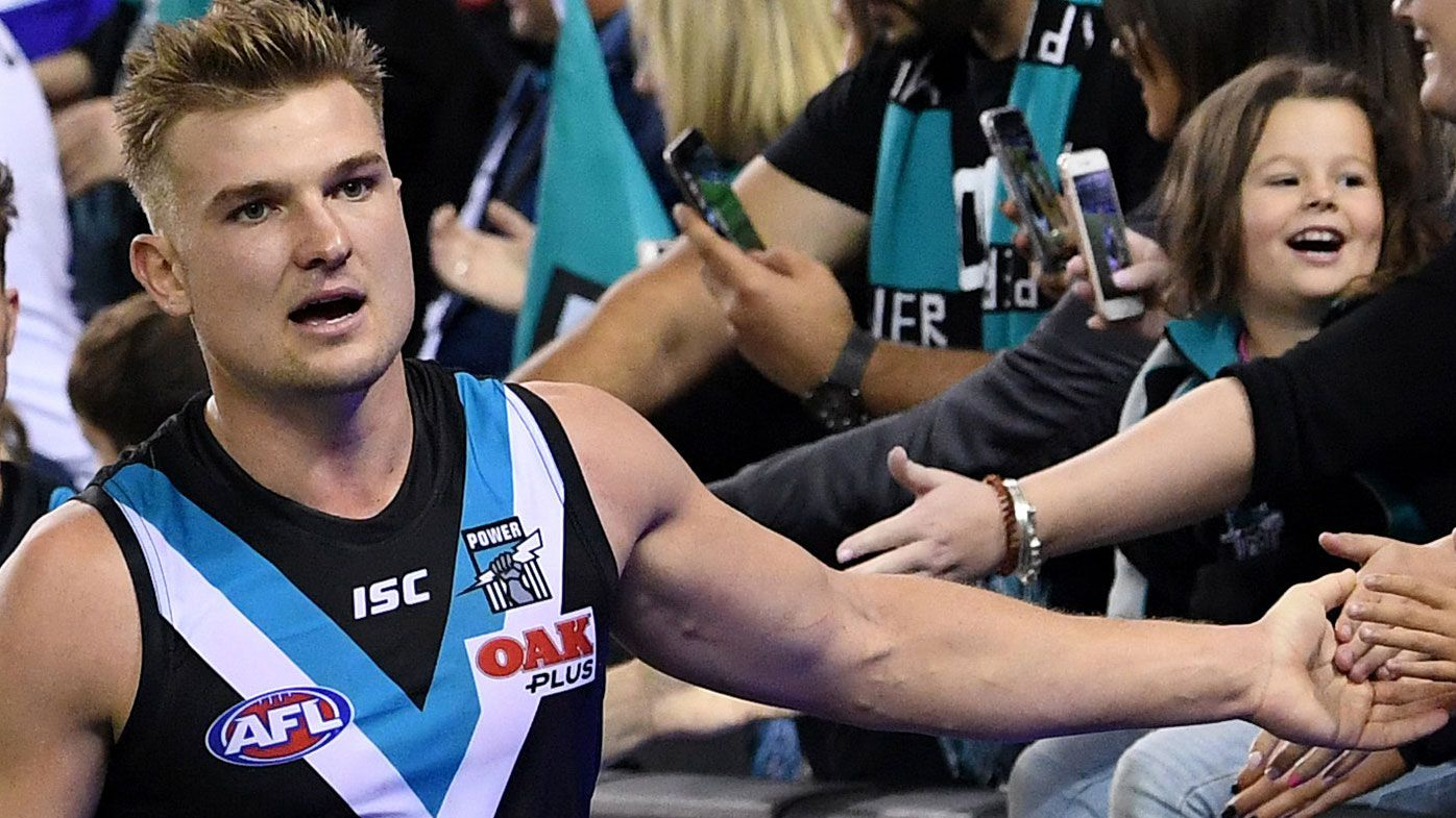 Port Adelaide superstar Ollie Wines re-signs with club on new four-year deal
