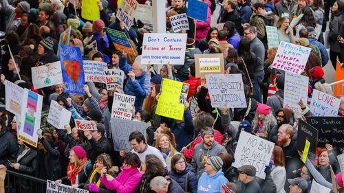 Donald Trump's travel ban is protested at Atlanta airport. (AAP)