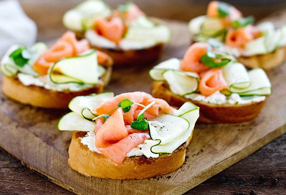 Barbecued garlic bread topped with goat's curd, smoked salmon and zucchini ribbons
