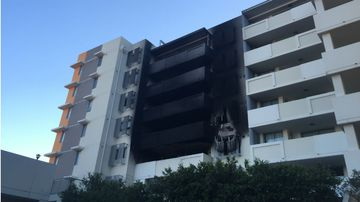 Fire flares up again at apartment building