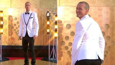 Television and radio presenter Jules Lund wore a smart white tux, posing cheekily on the red carpet.