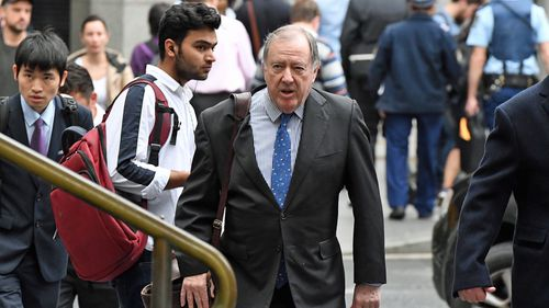 Magistrate Graeme Curran arrives at the Downing Centre Courts in Sydney, Friday, April 5, 2019.