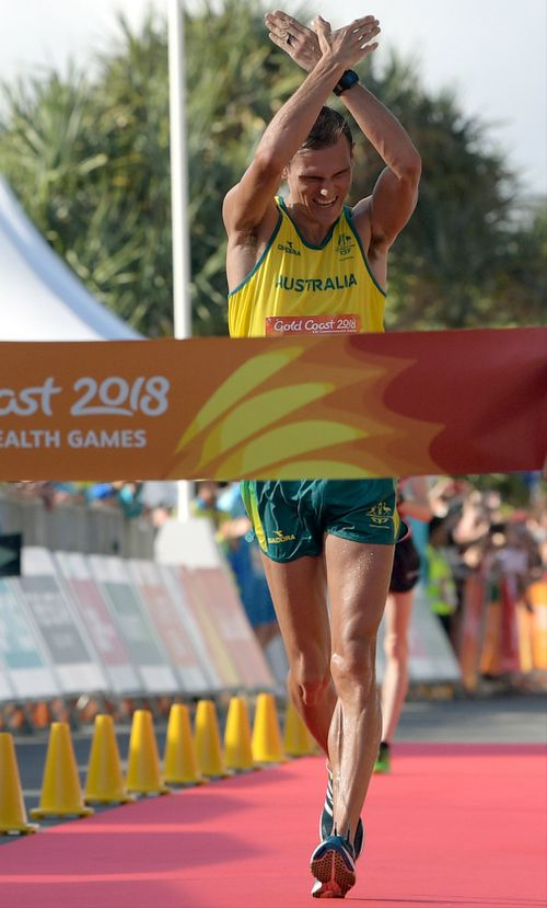 Dane Bird-Smith gestures while crossing the finish line. (AAP)
