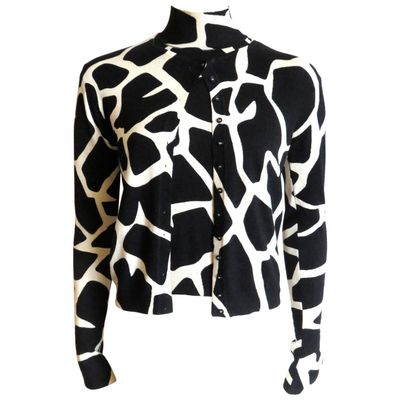 "<a href=""https://www.1stdibs.com/fashion/clothing/sweaters/1990s-john-galliano-paris-giraffe-print-silk-sweater-twinset/id-v_1387993"" target=""_blank"">Vintage '90s twin set, $653, John Galliano at 1stdibs</a>"