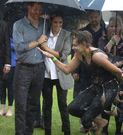 The couple had earlier watched an aboriginal dance performed in the rain.