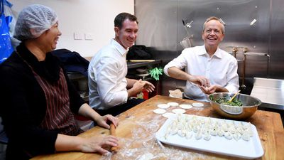 Bill Shorten and Labor candidate for Reid Sam Crosby make dumplings during a visit to a Chinese Restaurant in Burwood.