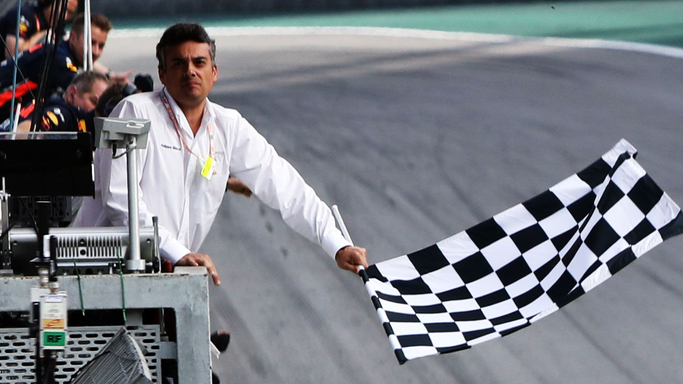 The chequered flag is waved during the F1 Grand Prix of Brazil