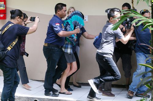 Australian woman charged with killing police officer in Bali