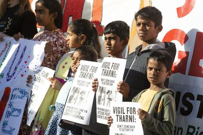 Young members of the public hold signs during a vigil outside the Perth Children's Hospital on June 13, 2021 in Perth, Australia. Three-year-old Tharnicaa, the daughter of the Tamil family from Biloela in Queensland, was medically evacuated from detention on Christmas Island to receive medical care in Perth after becoming sick. The family have been detained on Christmas Island since 2019. (Photo by Matt Jelonek/Getty Images)