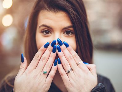 Woman with long painted nails.