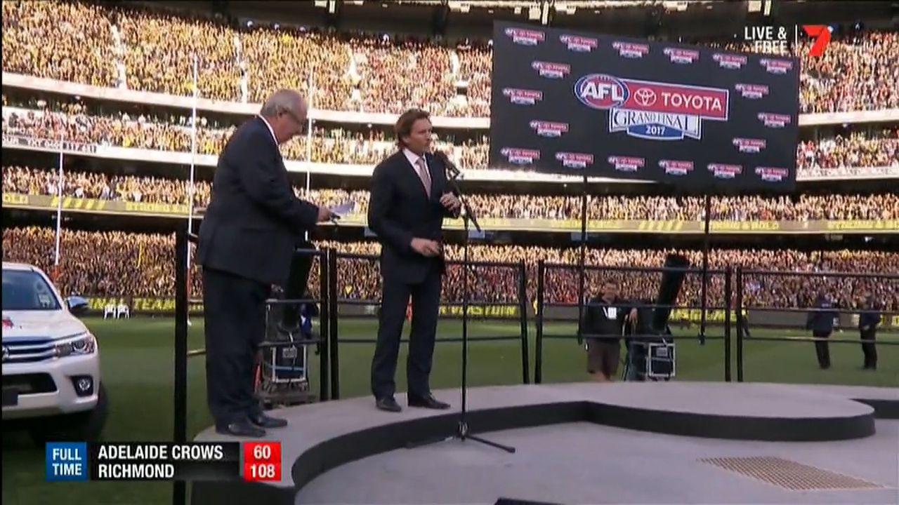 James Hird presents Norm Smith Medal