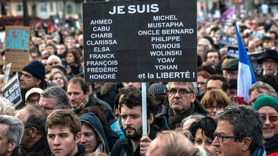 The crowd brandished banners paying tribute to the victims of the Charlie Hebdo shooting and subsequent supermarket siege.(Getty Images)