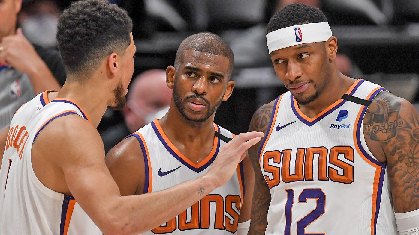 Chris Paul (3) and Torrey Craig (12) listen to Devin Booker (1) of the Phoenix Suns