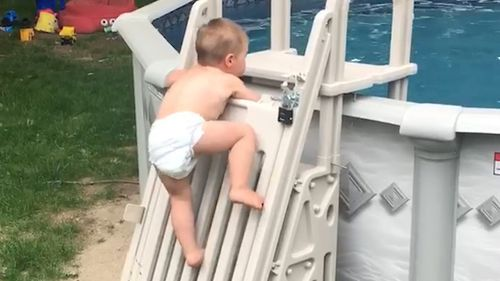 Cody was filmed by his dad scaling the locked pool ladder. (Facebook: Keith Wyman)
