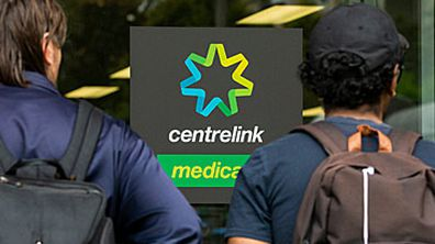 Young people outside Centrelink office (Getty)