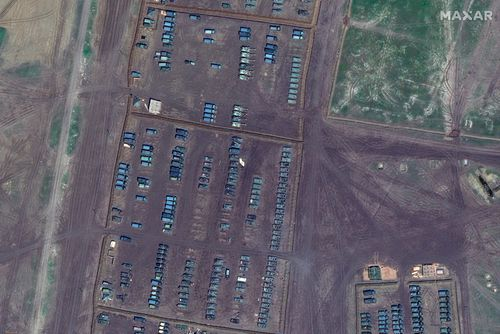 This image provided by Maxar Technologies shows overview of tanks, self propelled artillery and armored vehicles at Opuk training area at the Black Sea coast of Crimea on Thursday, April 15, 2021