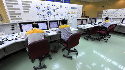 Iranian technicians work at the Bushehr nuclear power plant, outside the southern city of Bushehr, Iran. (AAP)