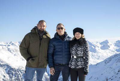 The pair pose with new Bond villain Hinx (Dave Bautista).