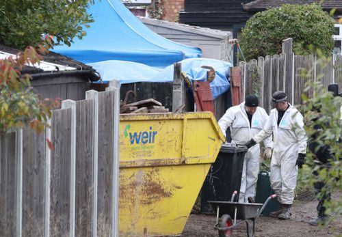 Police forensic experts search for clues in the garden of a house linked to the prime suspect in the Lamplugh case.