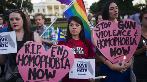 Members and supporters of the lesbian, gay, transgender, bisexual and queer (LGTBQ) community attend a candlelight vigil outside the White House to honor the victims of the mass shooting at Pulse. (EPA/Jim Lo Scalzo)