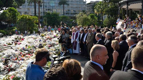 Nice mayor Philippe Pradal and President of the Provence Alpes Cote d'Azur region Christian Estrosi and religious leaders attend a wreath-laying ceremony along the promenade. (AAP)