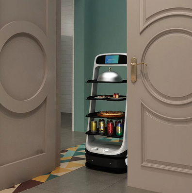 Robot table server with plates of food and drinks.