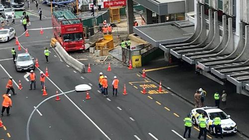 Witnesses claimed the City Sightseeing Tours bus rolled down the street with no driver inside before hitting the City Rail Link construction site.