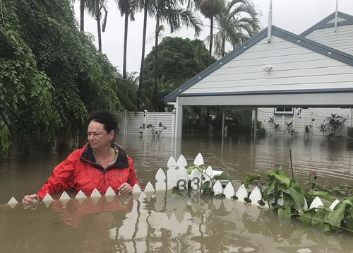 Andrew Rankin's shots of his wife Amelia at the couple's flooded home.