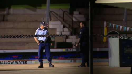 Police set up a crime scene at the pool. (9NEWS)