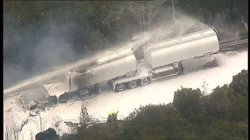 Ninety minutes after this M1 accident, two more truck drivers were killed in a head-on collision in Grafton (9NEWS).