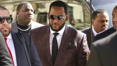 R&B singer R. Kelly, centre, arrives at the Leighton Criminal Court building for an arraignment on sex-related felonies in Chicago (Photo: June, 2019)