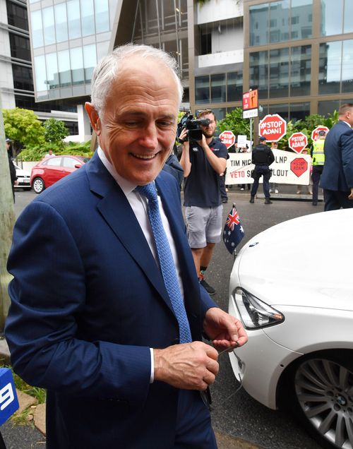 Malcolm Turnbull walks to his car at the LNP campaign launch in Brisbane today. (AAP)