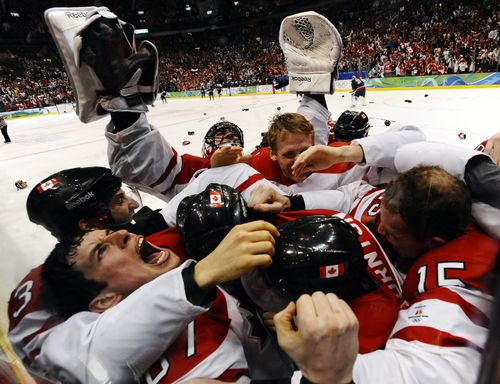 Sidney Crosbey celebrates with his teammates after their win in overtime of their Gold Medal game against the US. (AAP)