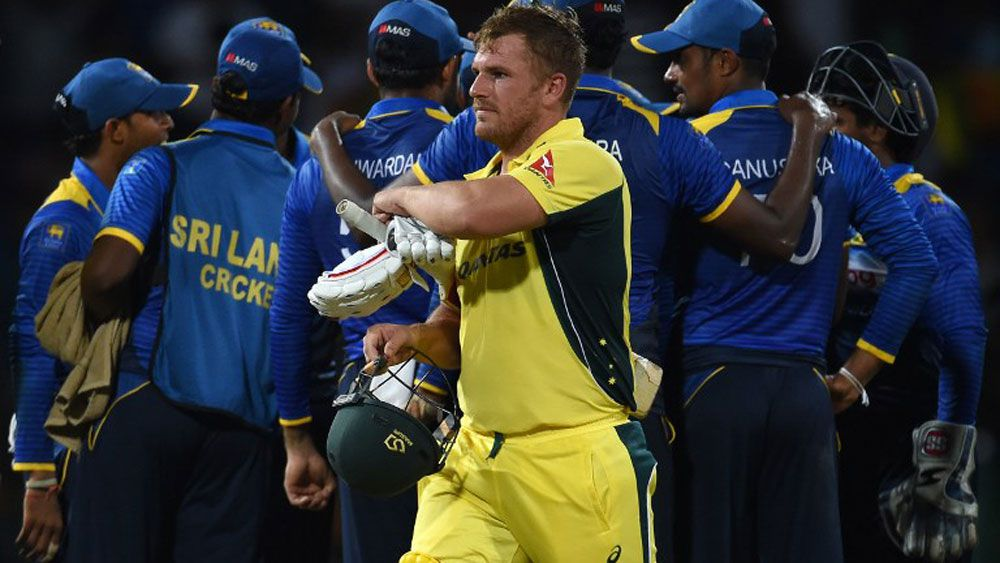Aaron Finch leaves the ground after being dismissed by Sri Lanka's Amila Aponso during the first ODI between Sri Lanka and Australia