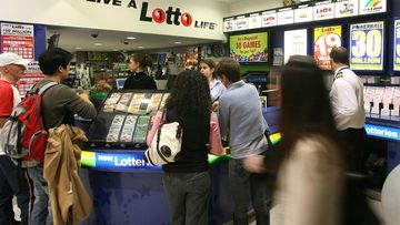 Punters queuing up at a newsagency to buy lottery tickets.