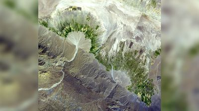 """""""In the Zagros Mountains of Iran, rainwater is scarce, and villagers rely on subterranean water supplies for irrigation. The ephemeral streams exiting the steep mountain fronts form large semi-circular alluvial fans, where the water moves through the subsurface towards the flat desert plains.""""(NASA/METI/AIST/Japan Space Systems, and U.S./Japan ASTER Science Team)"""