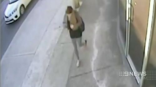The woman was caught on CCTV shortly after the alleged attack. (9NEWS)