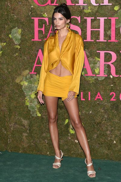 27-year-old model Emily Ratajkowski looked fierce in a silk yellow jacket by Roberto Cavalli with matching hot pants, strappy white sandals and gold disc earrings.