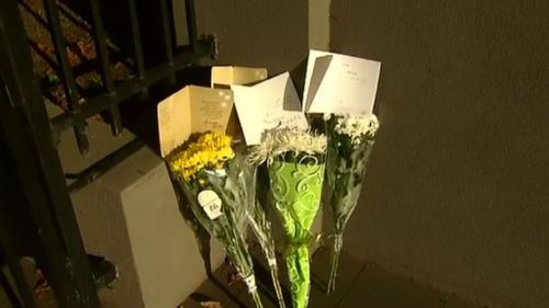 Floral tributes outside Mr Hao's workplace on Bay Street, Brighton. (9NEWS)