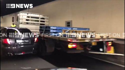 The car and a truck were involved in a crash. (9NEWS)