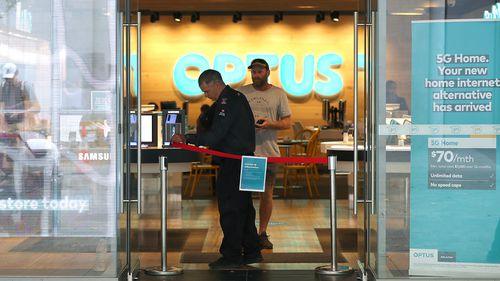 A customer inside an Optus store, one of three big mobile phone companies who have raised prices in Australia over the past 12 months.