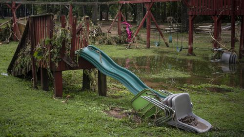 At least 22 people were killed and rescue crews searched desperately Sunday amid shattered homes and tangled debris for dozens of people still missing after record-breaking rain sent floodwaters surging through Middle Tennessee.