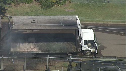 Semi-trailer bursts into flames after hitting powerlines at Ryde in Sydney's north