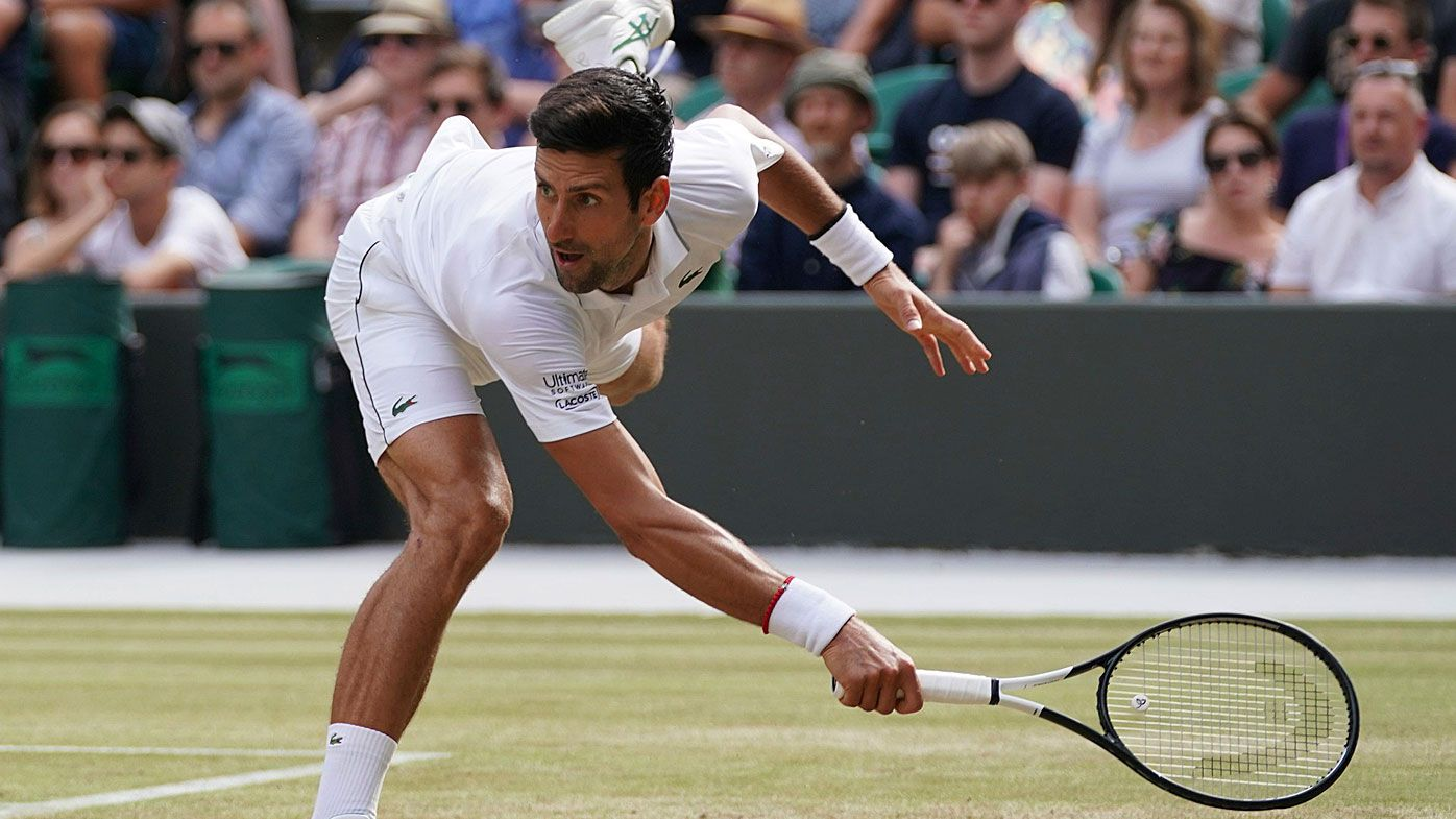 Djokovic hits a ball during the Men's singles third round