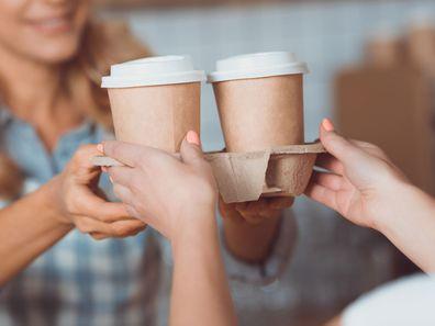 Woman buying takeaway coffee