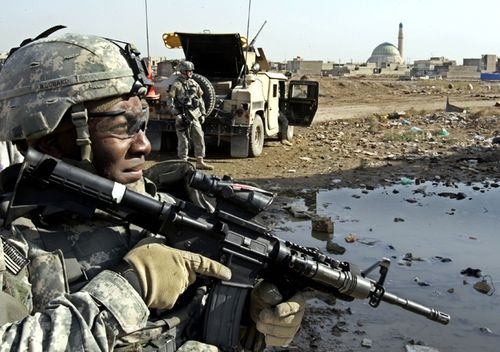 In this 2006 photo a US Army soldier from the 2nd Infantry Battalion, 17th Field Artillery Regiment looks on before the start of a mission to monitor a mosque during Friday prayers in Baghdad, Iraq.