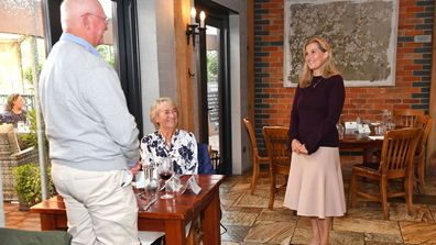 Sophie, Countess Of Wessex speaks to guests during her visit at 'The Half Moon' public house on July 08, 2020 in Windlesham, England
