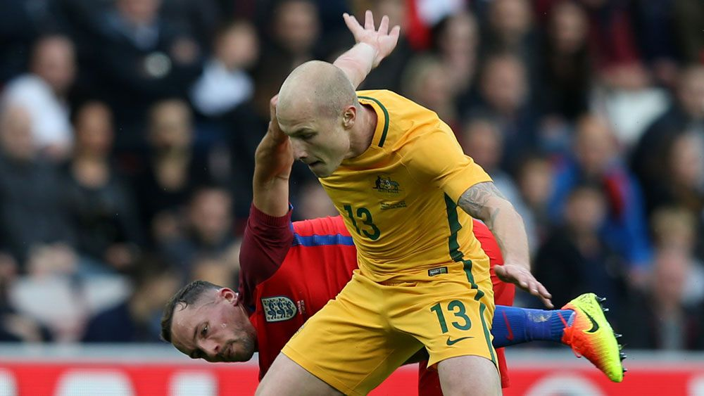 Upbeat Socceroos go down to England