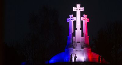 Monuments across the globe have been lit up in the French colours in a show of support and unity in the wake of the attacks. The Three Crosses in Vilnius, Lithuania, were lit up on Saturday. (AAP)