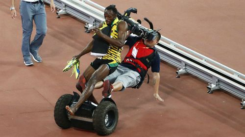 Usain Bolt is taken out by a cameraman on a Segway.